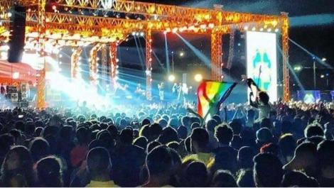Young people wave a rainbow flag at a Cairo concert featuring the Lebanese Band Mashrou' Leila. Activist Ahmed Alaa confirmed that he raised a rainbow flag at the concert in a Buzzfeed video including this image prior to his arrest.